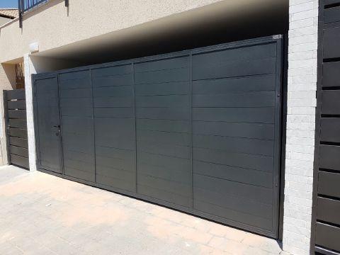 שערים - שערים -  דגם אטום - שער חניה וכניסה דגם אטום